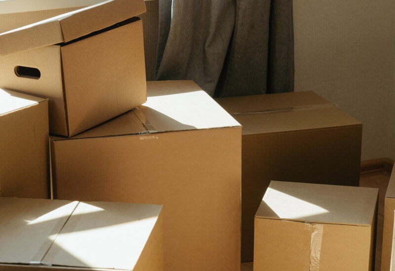 Packed boxes when house sale has fallen through